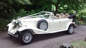 Beauford 4 Door Long body Wedding car. Click for more information.