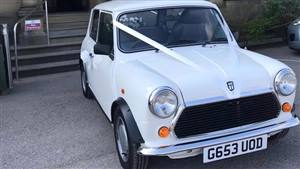 Mini 1990 City E Wedding car. Click for more information.