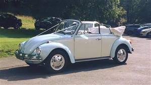 VW Beetle Karmann Convertible Wedding car. Click for more information.