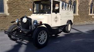 Fleur De Llys Vintage Coach Wedding car. Click for more information.