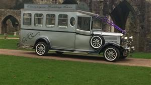 Asquith Vintage Coach Wedding car. Click for more information.