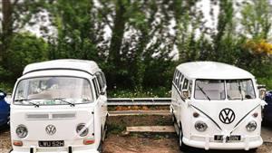 Two White VW Campervans Double campervan deal Wedding car. Click for more information.